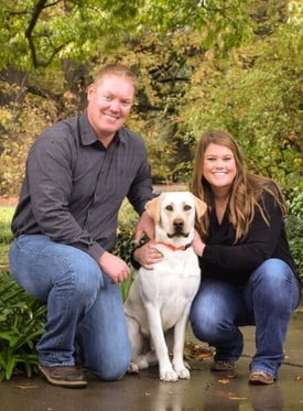 Dr. kendall willson with her husband and their dog